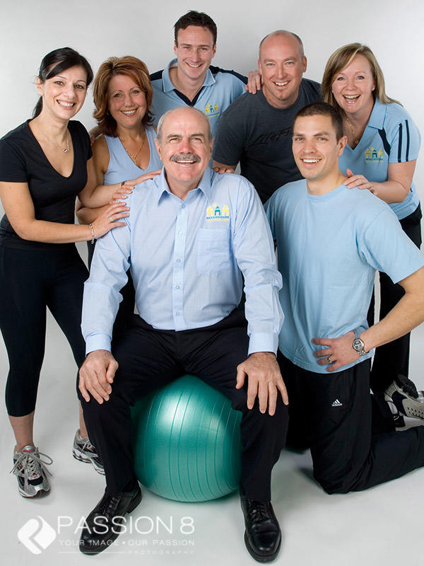 Gym headshot of the team with Leigh Matthews