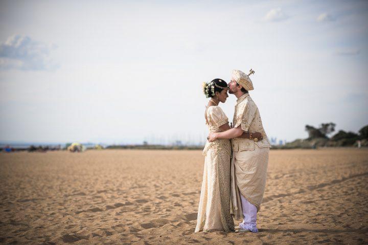 Wedding at the Brighton Savoy beach kiss